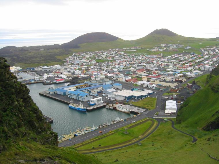 The Town of Heimaey, Iceland, Flanked by Two Volcanoes