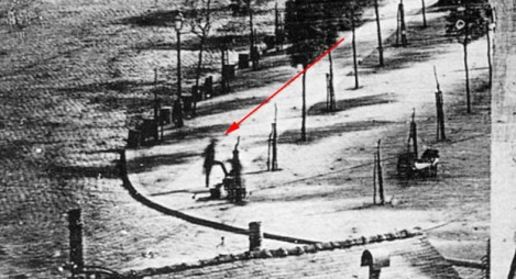 The Red Arrow is Pointing at the First Man Photographed