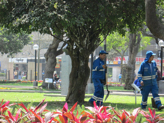 Uniformed Gardeners and Sanitation Workers in Parque Kennedy