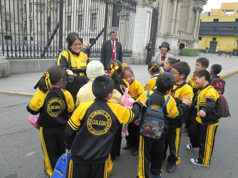 Schoolchildren with Teacher in Lima's Plaza de Armas