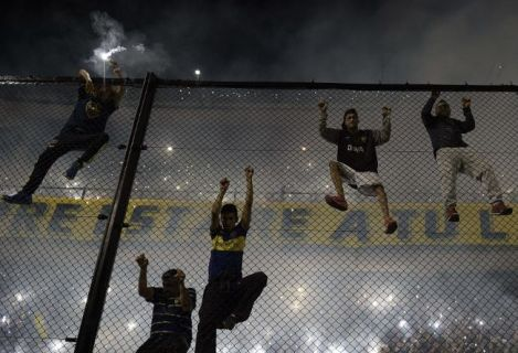 Fans Climbing Over High Security Barriers